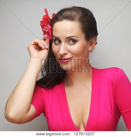 young happy woman with pink flower in the hair