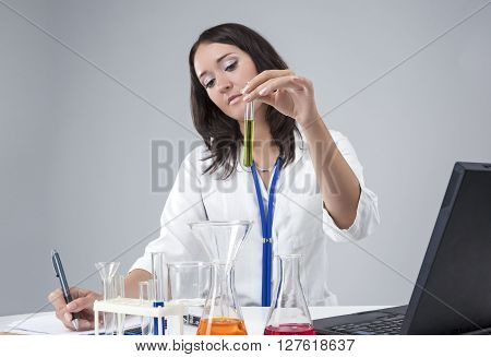 Medical Science Concepts and Ideas. Caucasian Female Lab Staff Dealing With Laboratory Glassware.Horizontal Image Composition