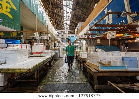 TOKYO, JAPAN - JUNE 2: Blurred unidentified worker ends his work in the famous tokyo fish market on June 2, 2015 in Japan