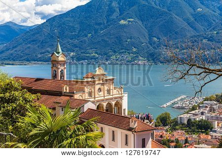 View of Madonna del Sasso Church above Locarno city and the Maggiore lake in Ticino Switzerland