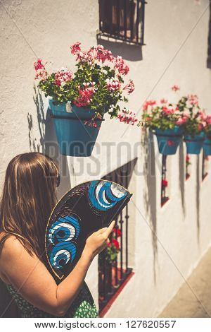 Young spanish woman with fan . Europe ** Note: Soft Focus at 100%, best at smaller sizes