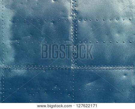 Abstract blue painted metal background. Texture with seams and rivets.