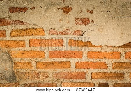 Brick walls make the house a lot of mortar and bricks began falling plaster decayed dilapidated.