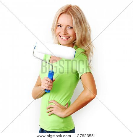 Young happy woman with paint roller isolated on white