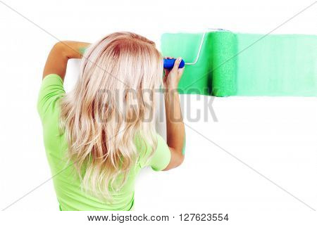 Woman painting wall with paint roller, isolated on white background