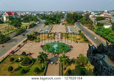 Vientiane Laos - March 16 2013: View of Patuxay park & Vientiane from top of Patuxay Victory Gate a war monument set in a public park in capital of Laos.