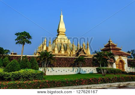 Pha That Luang - gold-covered Buddhist stupa in center of capital city Vientiane Laos. Most important national monument in Laos & national symbol.