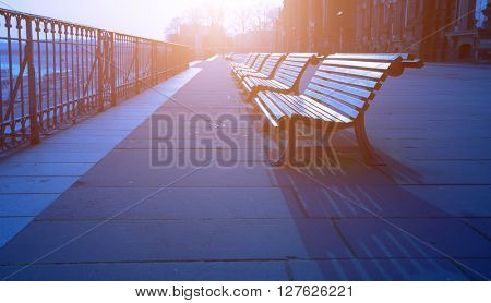 bench at morning  sunrise in empty city