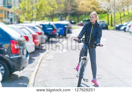 woman commuting on bicycle and looking at camera