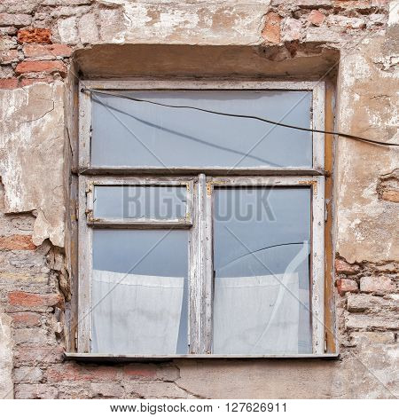 Old cracked grunge wall and window background