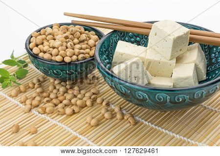 Tofu Cut Into Cubes With Soybeans In Bowl,  On White Background