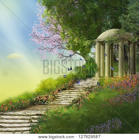 gazebo at the top of a hill with a stone stair and flowers