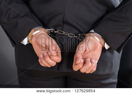 Close-up Of Businessman In Handcuffs