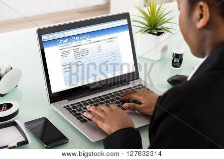 Businesswoman Using Online Banking Service On Laptop