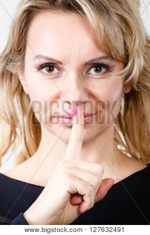 Blondie Woman With Silence Gesture