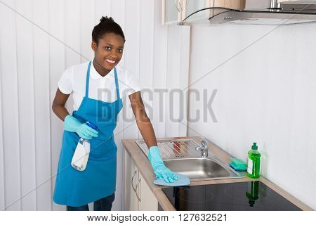 Female Janitor Cleaning Sink