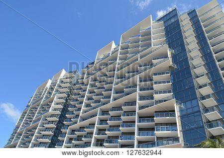 facade of a luxury high-rise condominium in miami beach,florida