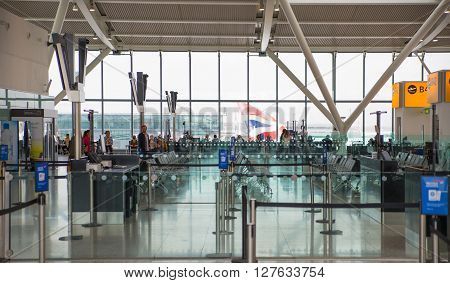 ROME, ITALY - APRIL 7, 2016: Interior of departure hall Heathrow Terminal 5 with lots of people waiting for call