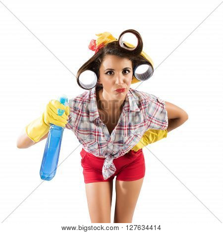 Simpering girl housewife with gloves and spray