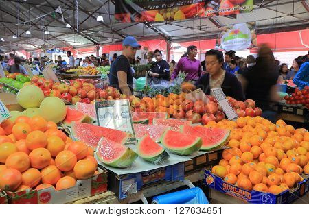 MELBOURNE AUSTRALIA - APRIL 24, 2016: Unidentified people visit Queen Victoria Market in Melbourne. Queen Victoria Market is the largest open air market in the Southern Hemisphere.