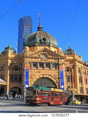 MELBOURNE AUSTRALIA - APRIL 24, 2016: Iconic tram runs in front of Flinders Street Station in Melbourne.