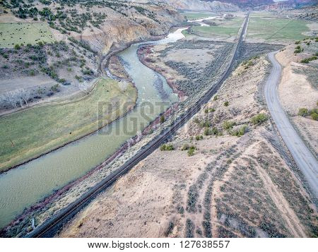 aerial view railroad, highway and  of the Colorado RIver above Dotsero, Colorado, springtime scenery