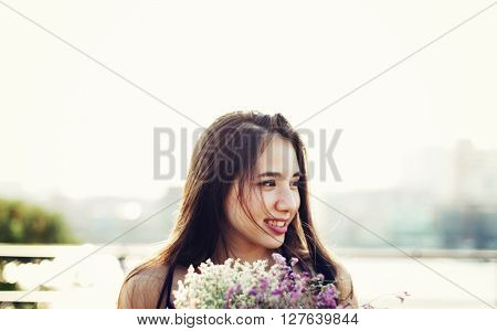 Young Happy Woman Holding Flowers Concept