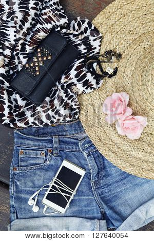 Top view of girly outfit with fashionable details