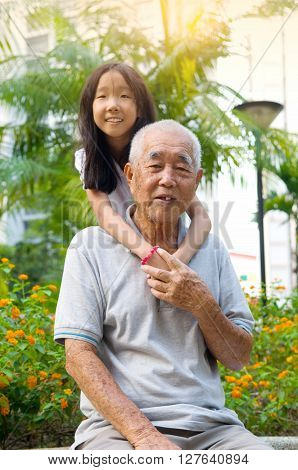 Happy Asian Grandfather posing with his grandchildren ** Note: Soft Focus at 100%, best at smaller sizes