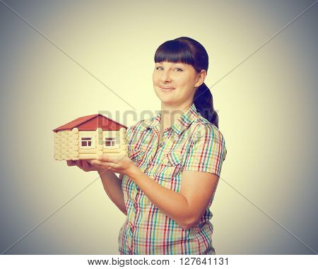 Girl Holding A House