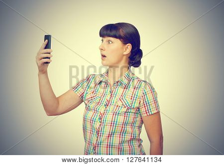 Brunette Stares At The Cell Phone Screen.