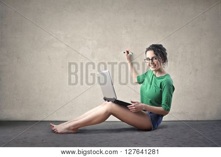 Happy girl taking notes