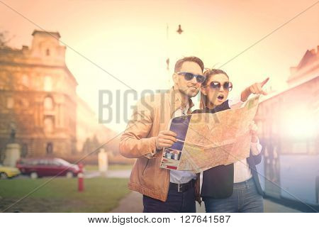 Tourists holding a map