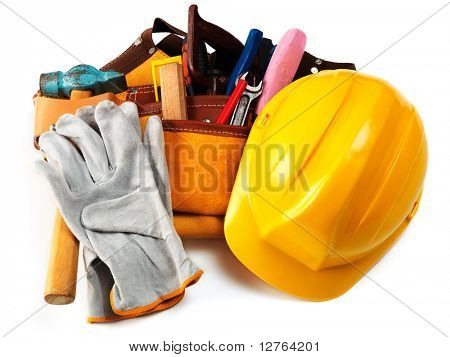 Yellow helmet and different tools isolated on white