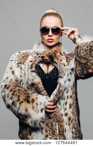 Portrait of a beautiful model in fur. Fur coat winter fashion elegant Woman clothes in  lynx fur coat.