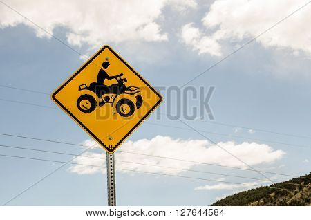 Sign to warn of ATVs crossing the road. As you can see this new sign already has a bullet hole in it.