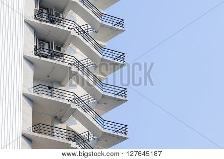 the fire escape which is a part of building with the sky and cloud