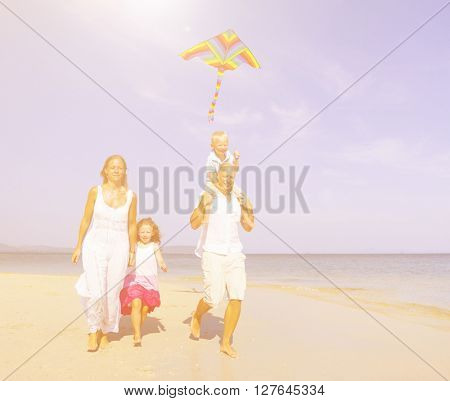 Family Walking Beach Concept