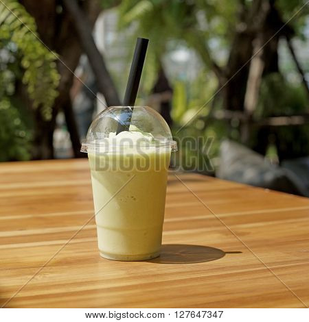 smoothy cantaloupe melon juice on wooden table