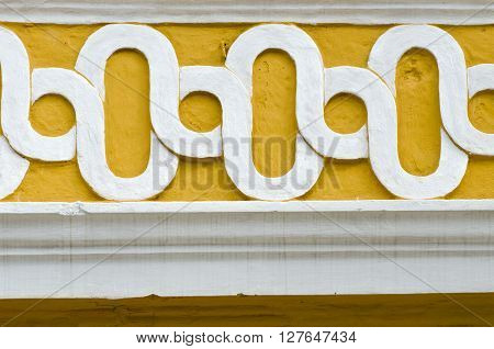 white and yellow concrete ornament on the wall India