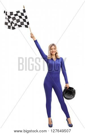 Full length portrait of an attractive blond woman waving a checkered race flag isolated on white background