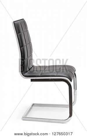 Vertical studio shot of a new black leather office chair isolated on white background