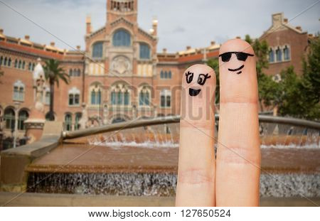 travel, tourism, couple, people and body parts concept - close up of two fingers with smiley faces