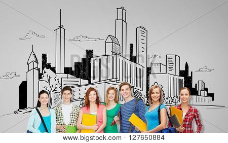 education, school and people concept - group of smiling teenage students with folders and school bags over city drawing background