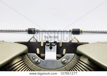 Close-up of word Cancer on typewriter sheet