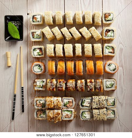 Set of Maki Sushi on Wooden Background