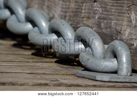 strong chain at a drawbridge of a castle