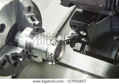 metal working. cutting tool pefroming turning operation at cnc machine