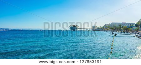 EILAT ISRAEL - FEBRUARY 23 2016: The view on the Red Rocks Beach and the dive station in the sea on February 23 in Eilat.