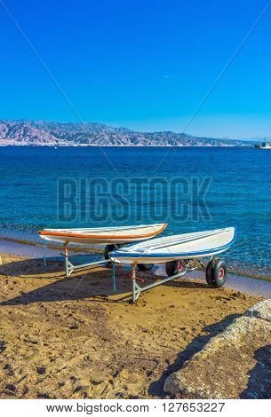 Two surfboards on the trailers after the surfing in Aqaba Gulf Eilat Israel.